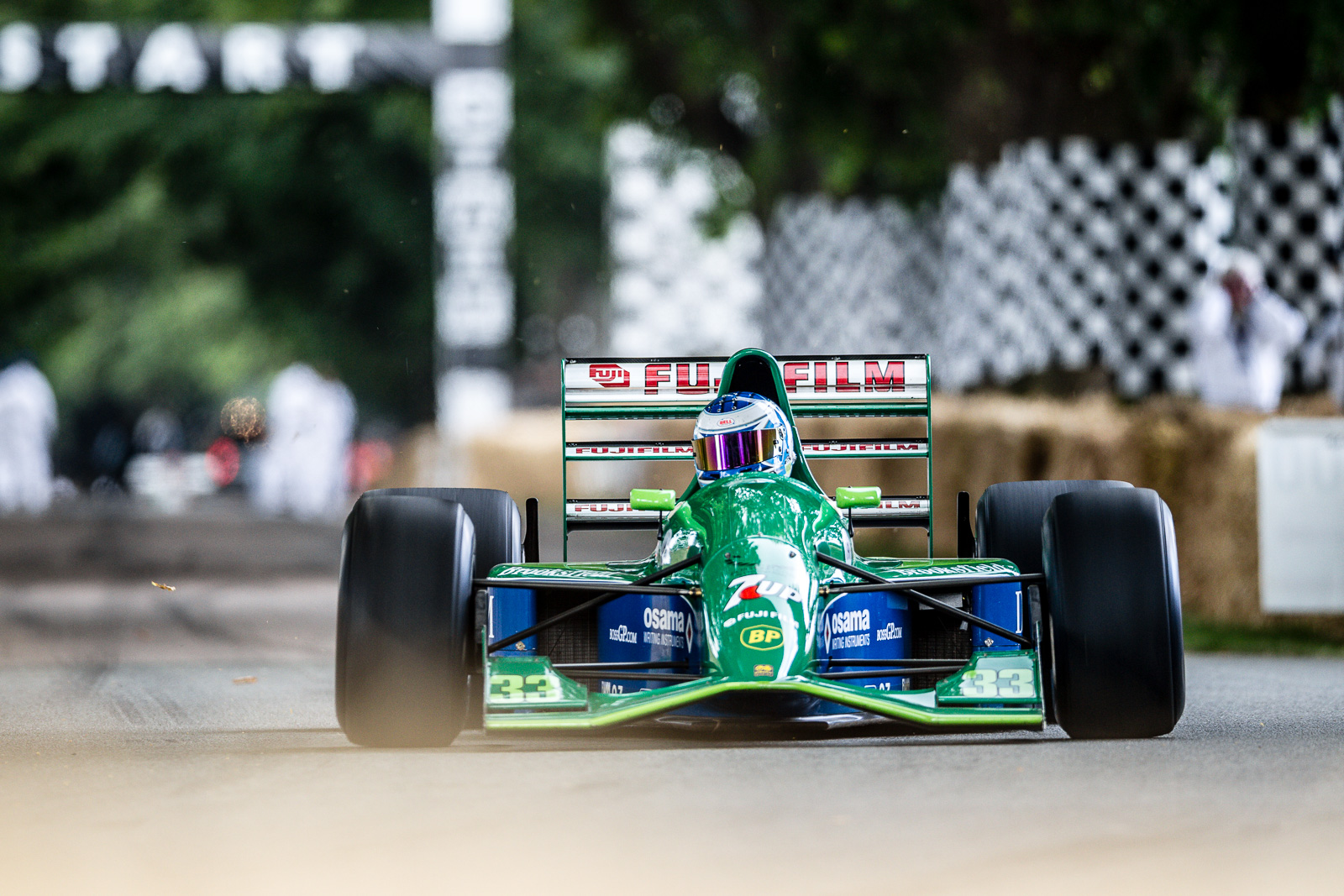 Formula 1 car racing down the straight at the goodwood Festival of Speed